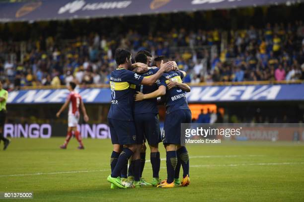Dario Benedetto of Boca Juniors celebrates with teammates after scoring the second goal of his team during a match between Boca Juniors and Union as...