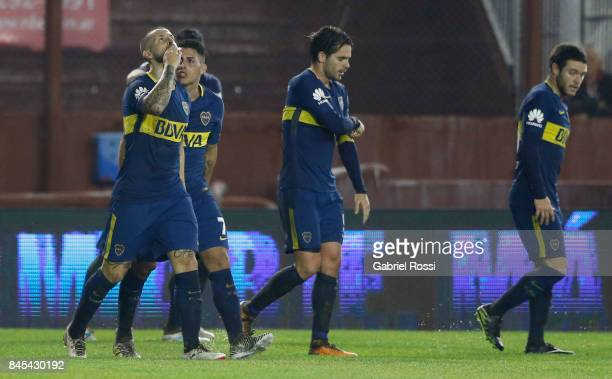Dario Benedetto of Boca Juniors celebrates with teammates after scoring the first goal of his team during a match between Lanus and Boca Juniors as...