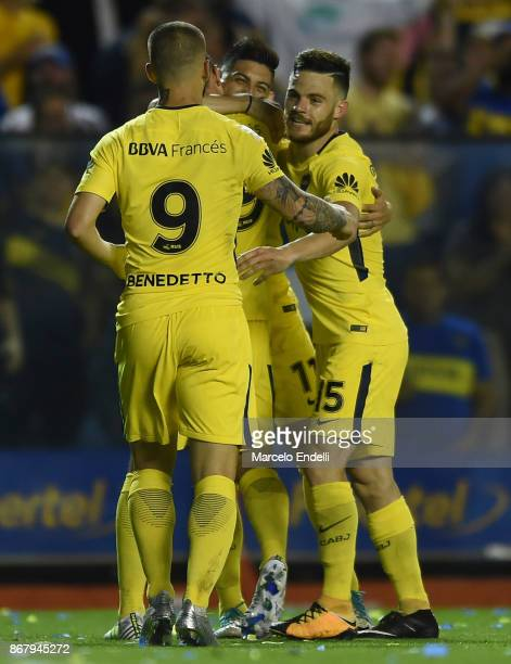 Dario Benedetto of Boca Juniors celebrates with teammates after scoring the fourth goal of his team during a match between Boca Juniors and Belgrano...