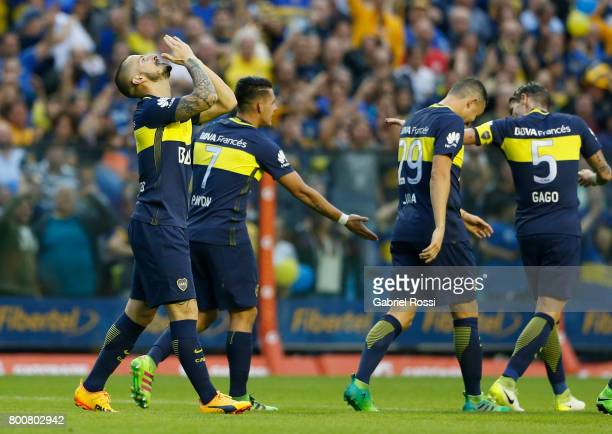 Dario Benedetto of Boca Juniors celebrates with teammates Cristian Pavon Fernando Gago and Leonardo Jara after scoring the second goal of his team...