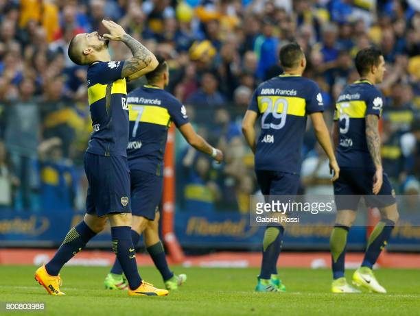 Dario Benedetto of Boca Juniors celebrates with teammates Cristian Pavon Fernando Gago and Leonardo Jara after scoring the second goal of his team...