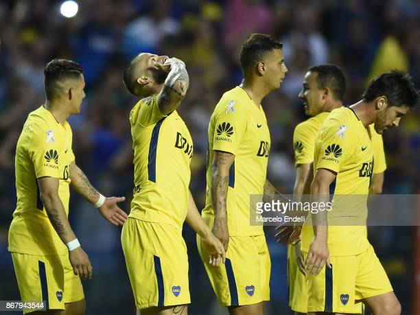 Dario Benedetto of Boca Juniors celebrates with teammates Cristian Pavon Edwin Cardona Pablo Perez and Leonardo Jara after scoring the third goal of...