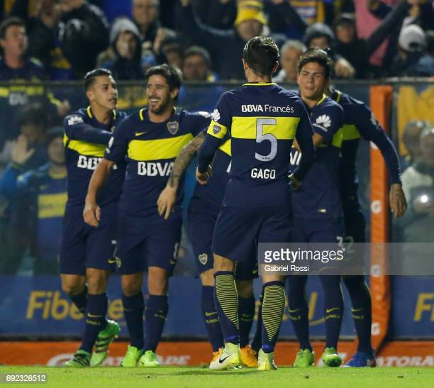 Dario Benedetto of Boca Juniors celebrates with teammates Fernando Gago Jonathan Silva Oscar Benitez and Cristian Pavon after scoring the first goal...