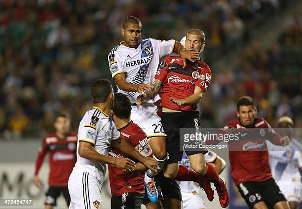 Dario Benedetto of Club Tijuana and Leonardo of the Los Angeles Galaxy vie for the ball from a corner kick in the second half of the CONCACAF...