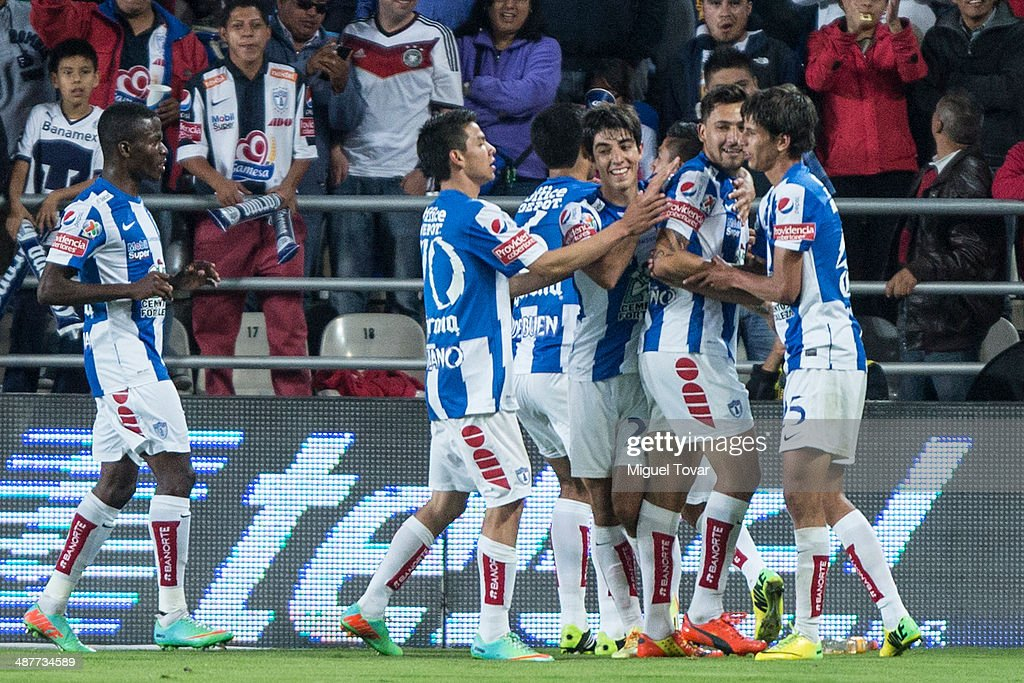 Dario Carre–o of Pachuca celebrates after scoring with teammates during the Quarterfinal first leg match between Pumas UNAM and Pachuca as part of...