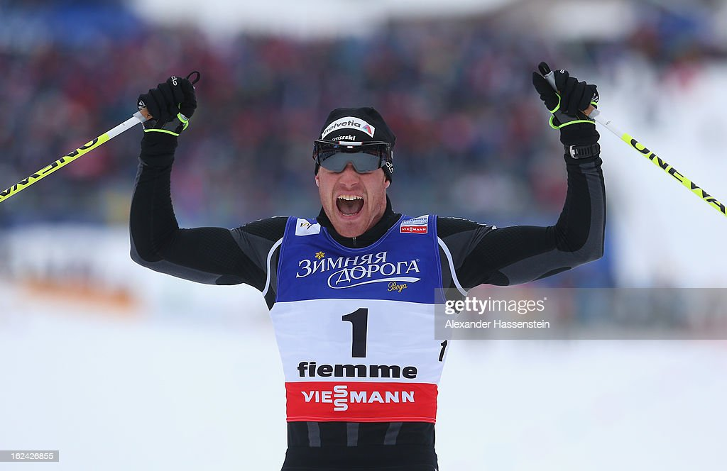 Dario Cologna of Switzerland celebrates victory in the Men's Skiathlon at the FIS Nordic World Ski Championships on February 23, 2013 in Val di Fiemme, Italy.