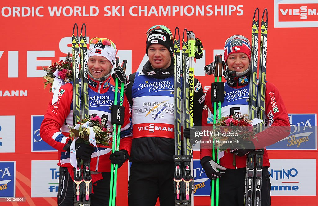 <a gi-track='captionPersonalityLinkClicked' href=/galleries/search?phrase=Dario+Cologna&family=editorial&specificpeople=4779620 ng-click='$event.stopPropagation()'>Dario Cologna</a> of Switzerland celebrates victory with second placed Martin Sundby of Norway (l) and third placed Sjur Roethe of Norway (r) in the Men's Skiathlon at the FIS Nordic World Ski Championships on February 23, 2013 in Val di Fiemme, Italy.
