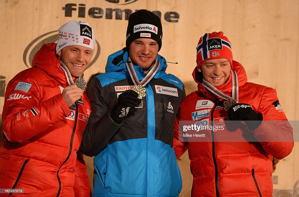 <a gi-track='captionPersonalityLinkClicked' href=/galleries/search?phrase=Dario+Cologna&family=editorial&specificpeople=4779620 ng-click='$event.stopPropagation()'>Dario Cologna</a> of Switzerland celebrates with his Gold medal alongside Silver medalist Martin Sundby of Norway (l) and Bronze medalist Sjur Roethe of Norway (r) at the medal ceremony for the Men's Skiathlon at the FIS Nordic World Ski Championships on February 23, 2013 in Val di Fiemme, Italy.