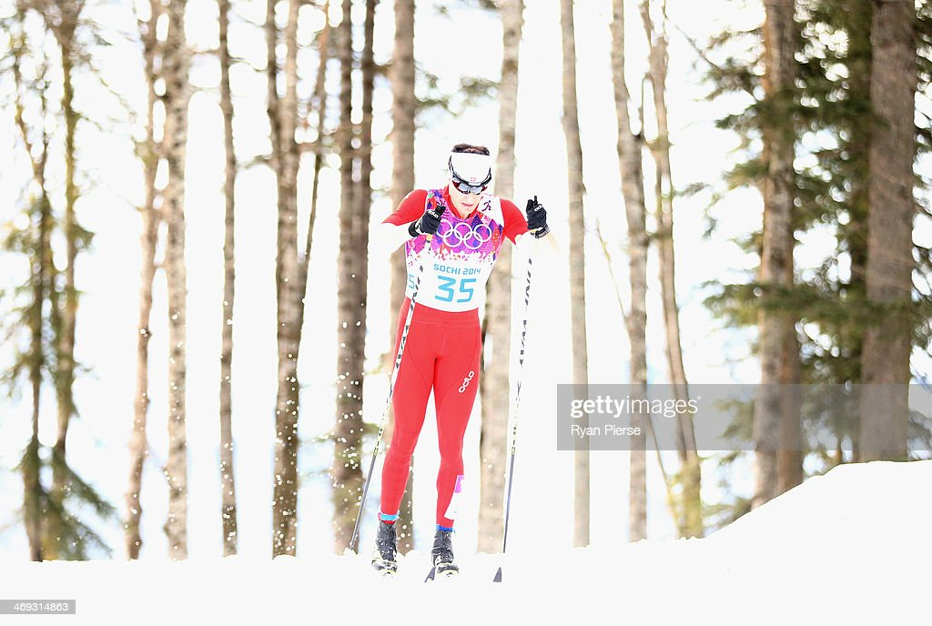 <a gi-track='captionPersonalityLinkClicked' href=/galleries/search?phrase=Dario+Cologna&family=editorial&specificpeople=4779620 ng-click='$event.stopPropagation()'>Dario Cologna</a> of Switzerland competes during the Cross Country Men's 15km Classic on day seven of the Sochi 2014 Winter Oympics at Laura Cross-country Ski & Biathlon Center on February 14, 2014 in Sochi, Russia.