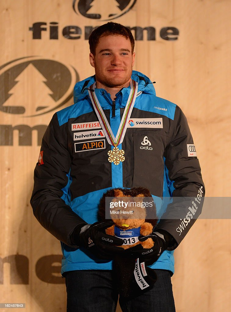 <a gi-track='captionPersonalityLinkClicked' href=/galleries/search?phrase=Dario+Cologna&family=editorial&specificpeople=4779620 ng-click='$event.stopPropagation()'>Dario Cologna</a> of Switzerland poses with his Gold medal at the medal ceremony for the Men's Skiathlon at the FIS Nordic World Ski Championships on February 23, 2013 in Val di Fiemme, Italy.