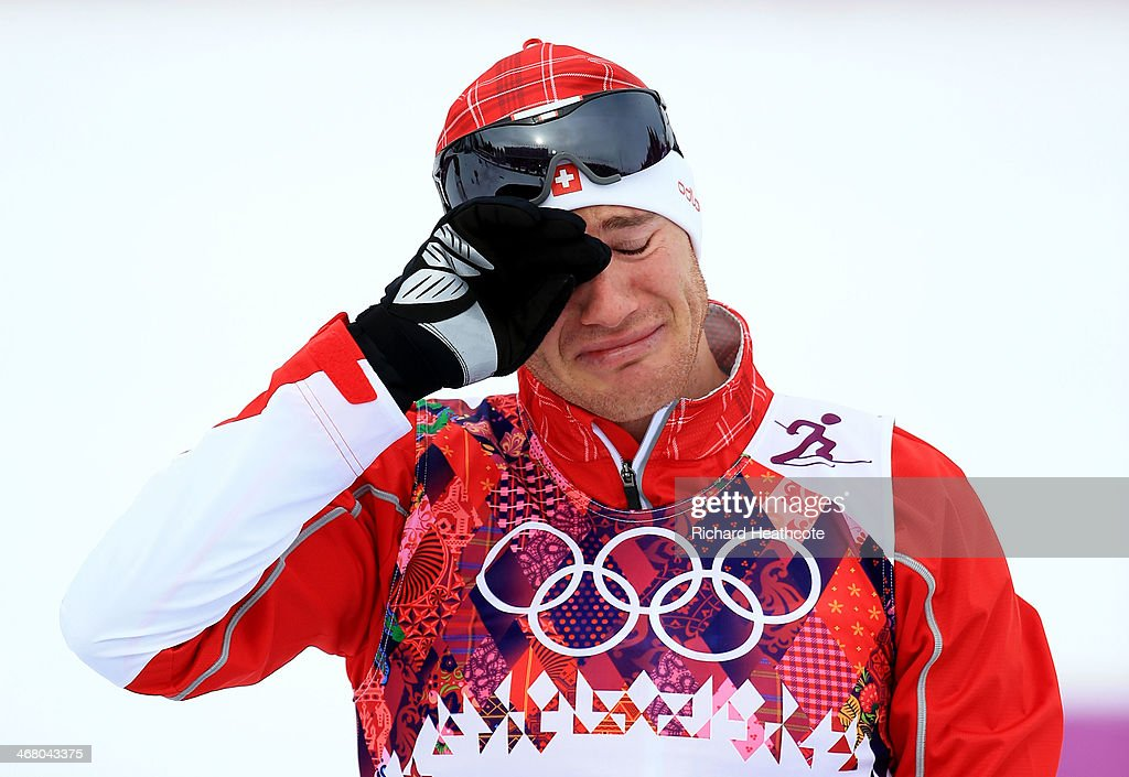 <a gi-track='captionPersonalityLinkClicked' href=/galleries/search?phrase=Dario+Cologna&family=editorial&specificpeople=4779620 ng-click='$event.stopPropagation()'>Dario Cologna</a> of Switzerland reacts to winning the Men's Skiathlon 15 km Classic + 15 km Free during day two of the Sochi 2014 Winter Olympics at Laura Cross-country Ski & Biathlon Center on February 9, 2014 in Sochi, Russia.