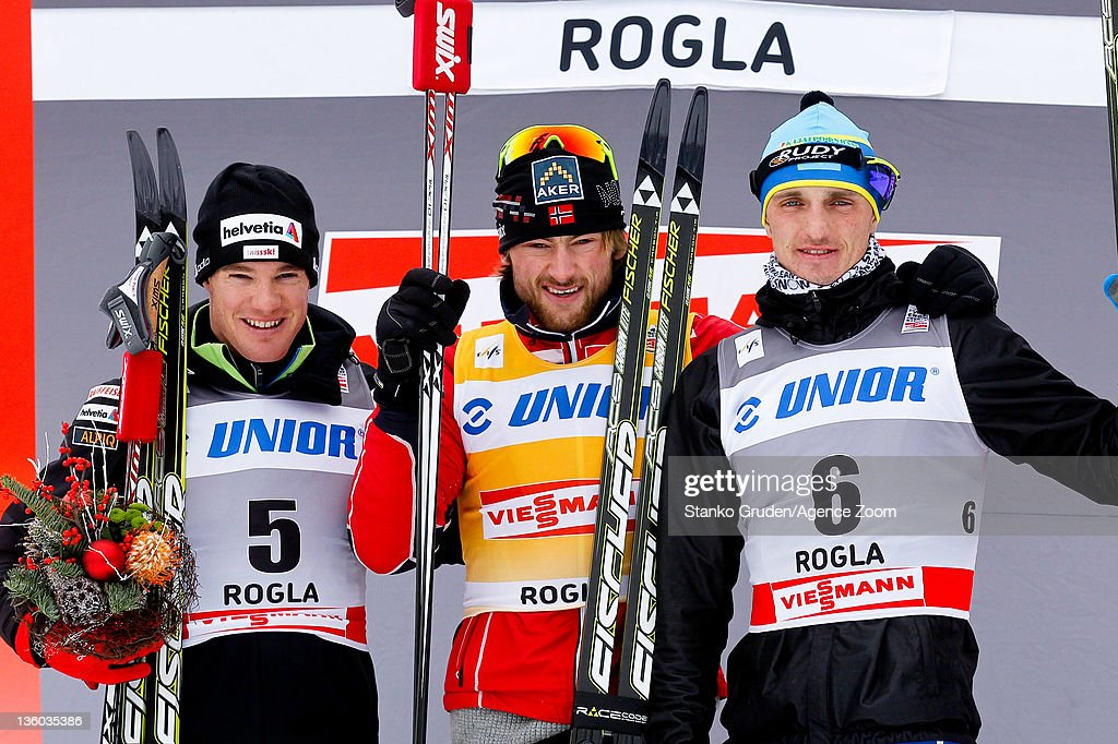 <a gi-track='captionPersonalityLinkClicked' href=/galleries/search?phrase=Dario+Cologna&family=editorial&specificpeople=4779620 ng-click='$event.stopPropagation()'>Dario Cologna</a> of Switzerland takes 2nd place, Petter jr. Northug of Norway takes 1st place, Alexey Poltaranin of Kazakstan takes 3th place during the FIS Cross Country World Cup Men's 15km Mass Start on December 17, 2011 in Rogla, Slovenia.