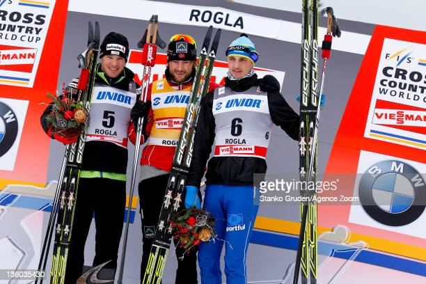 Dario Cologna of Switzerland takes 2nd place Petter jr Northug of Norway takes 1st place Alexey Poltaranin of Kazakstan takes 3th place during the...
