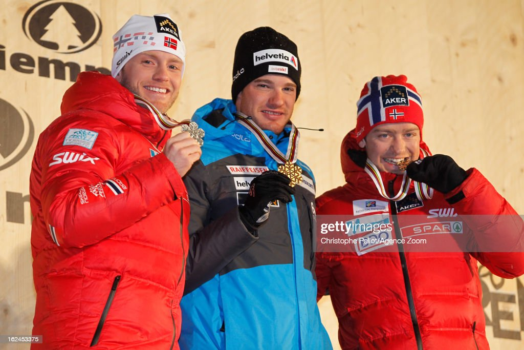 <a gi-track='captionPersonalityLinkClicked' href=/galleries/search?phrase=Dario+Cologna&family=editorial&specificpeople=4779620 ng-click='$event.stopPropagation()'>Dario Cologna</a> of Switzerland takes the gold medal, <a gi-track='captionPersonalityLinkClicked' href=/galleries/search?phrase=Martin+Johnsrud+Sundby&family=editorial&specificpeople=4668146 ng-click='$event.stopPropagation()'>Martin Johnsrud Sundby</a> of Norway takes the silver medal, Sjur Roethe of Norway takes the bronze medal during the FIS Nordic World Ski Championships Men's Cross Country Skiathlon on February 23, 2013 in Val di Fiemme, Italy.