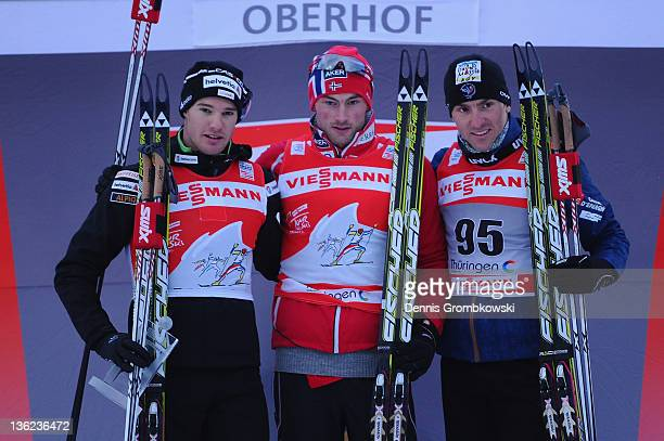Dario Cologna Petter Northug Jr and Maurice Manificat pose after the FIS Tour de Ski Oberhof Men's Prolouge at DKB Ski Arena on December 29 2011 in...