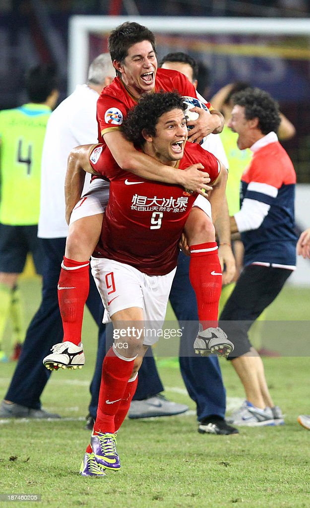 Dario Conca and Elkeson of Guangzhou Evergrande celebrate after winning the AFC Champions League Final 2nd leg match against FC Seoul at Tianhe...