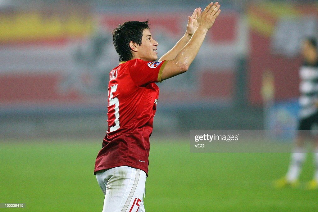 Dario Conca of Guangzhou Evergrande celebrates after scoring his team's first goal during the AFC Champions League match between Guangzhou Evergrande...