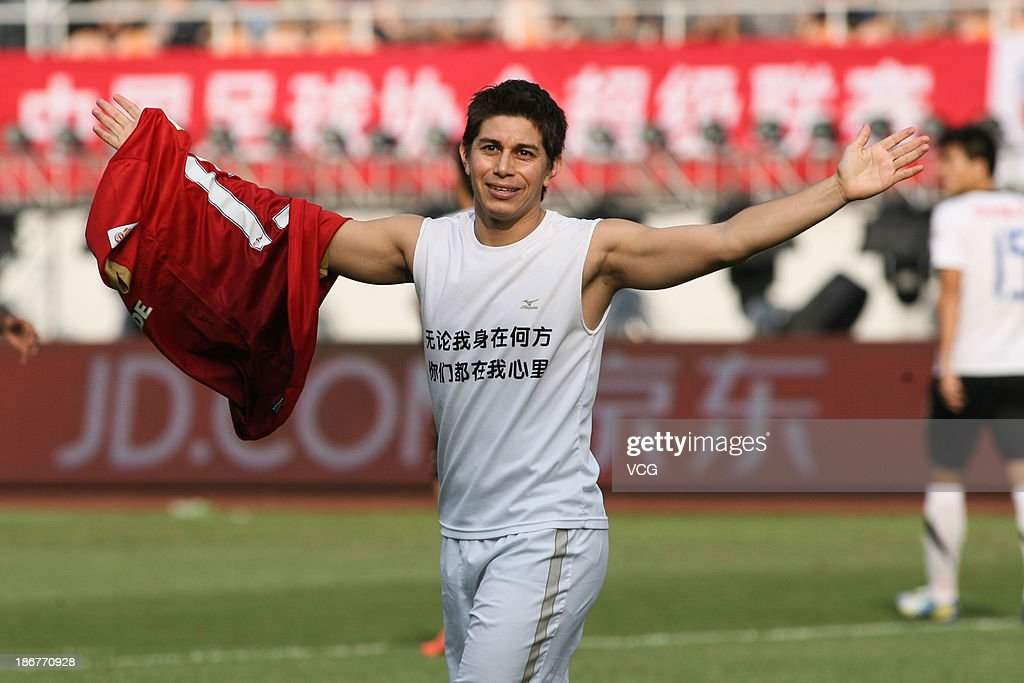 <a gi-track='captionPersonalityLinkClicked' href=/galleries/search?phrase=Dario+Conca&family=editorial&specificpeople=795858 ng-click='$event.stopPropagation()'>Dario Conca</a> #15 of Guangzhou Evergrande celebrates after scoring his team's second goal during the Chinese Super League match between Guangzhou Evergrande and Wuhan Zall at Tianhe Sports Center on November 3, 2013 in Guangzhou, China.