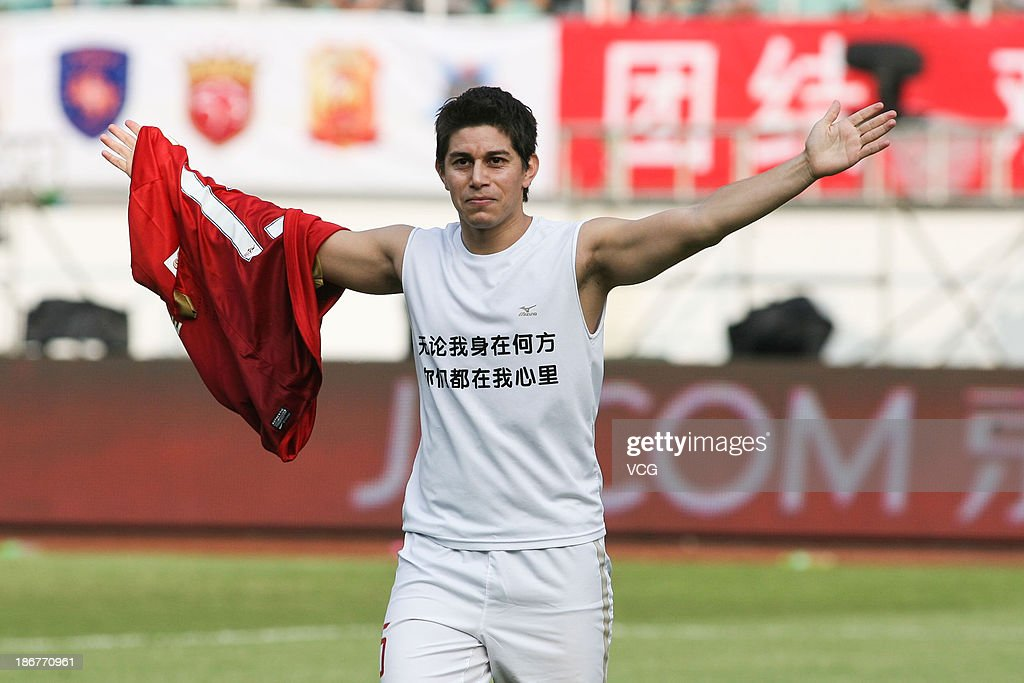 Dario Conca #15 of Guangzhou Evergrande celebrates after scoring his team's second goal during the Chinese Super League match between Guangzhou Evergrande and Wuhan Zall at Tianhe Sports Center on November 3, 2013 in Guangzhou, China.