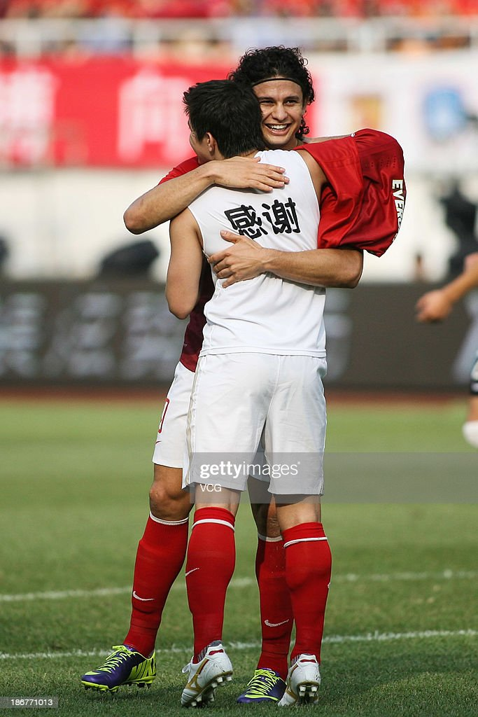 Dario Conca (R) of Guangzhou Evergrande celebrates with team-mate and fellow goal-scorer Elkeson after scoring their team's second goal during the Chinese Super League match between Guangzhou Evergrande and Wuhan Zall at Tianhe Sports Center on November 3, 2013 in Guangzhou, China.