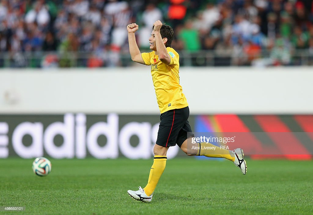 Dario Conca of Guangzhou Evergrande FC celebrates after scoring the second goal during the FIFA Club World Cup Quarter Final match between Guangzhou...