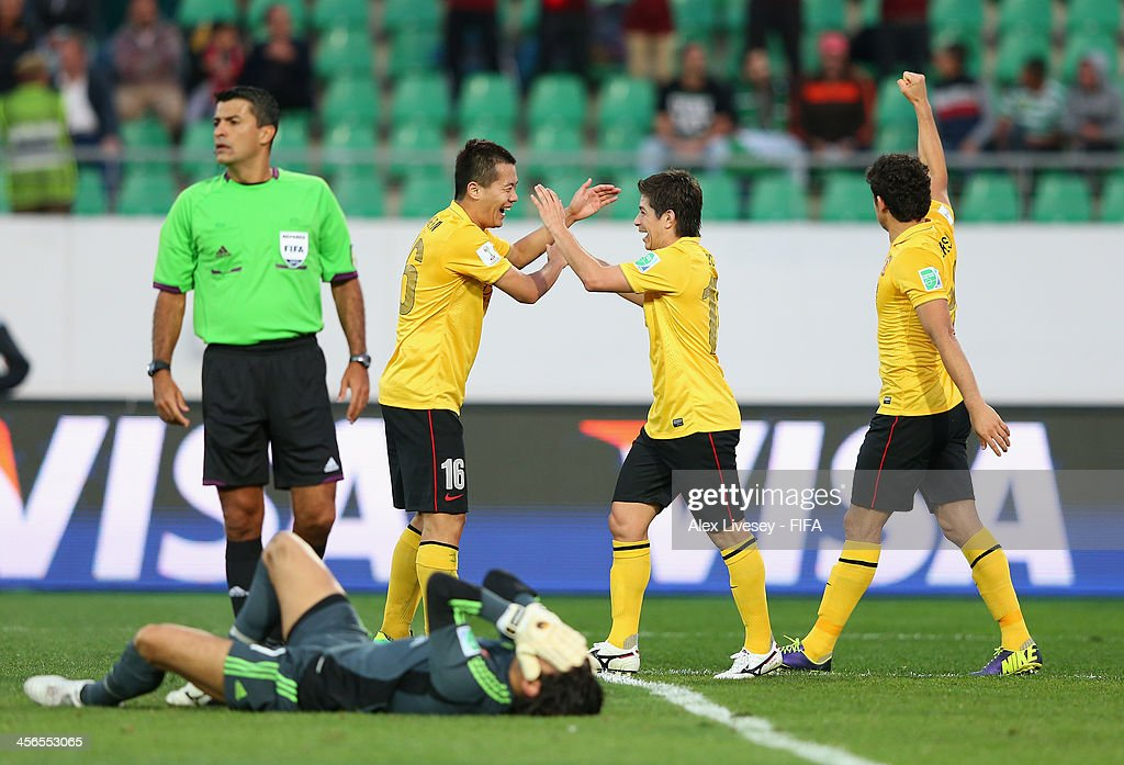 Dario Conca of Guangzhou Evergrande FC celebrates with Bowen Huang after scoring the second goal as Sherif Ekramy the goalkeeper of AlAhly looks...