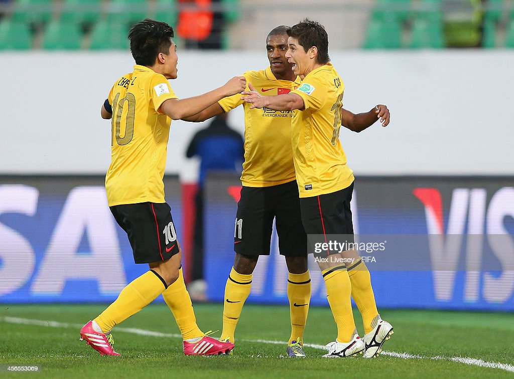 Dario Conca of Guangzhou Evergrande FC celebrates with Muriqui and Zhi Zheng after scoring the second goal during the FIFA Club World Cup Quarter...