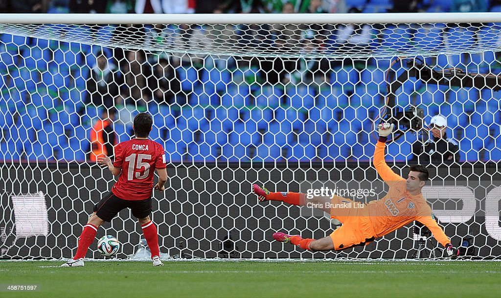 Dario Conca of Guangzhou Evergrande FC scores his side's second goal from the penalty spot past Victor of Atletico Mineiro during the FIFA Club World...
