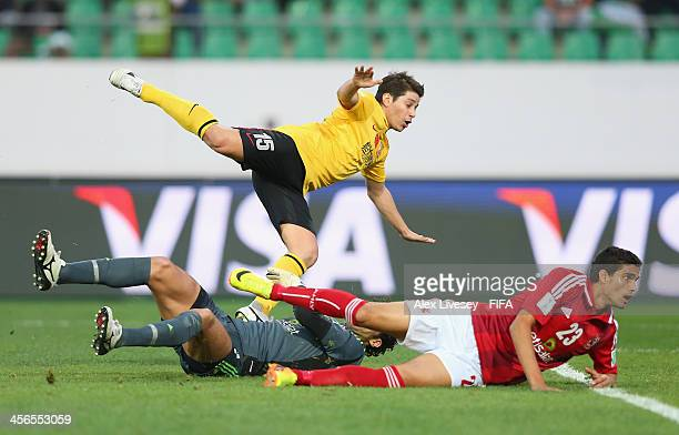 Dario Conca of Guangzhou Evergrande FC scores the second goal during the FIFA Club World Cup Quarter Final match between Guangzhou Evergrande FC and...