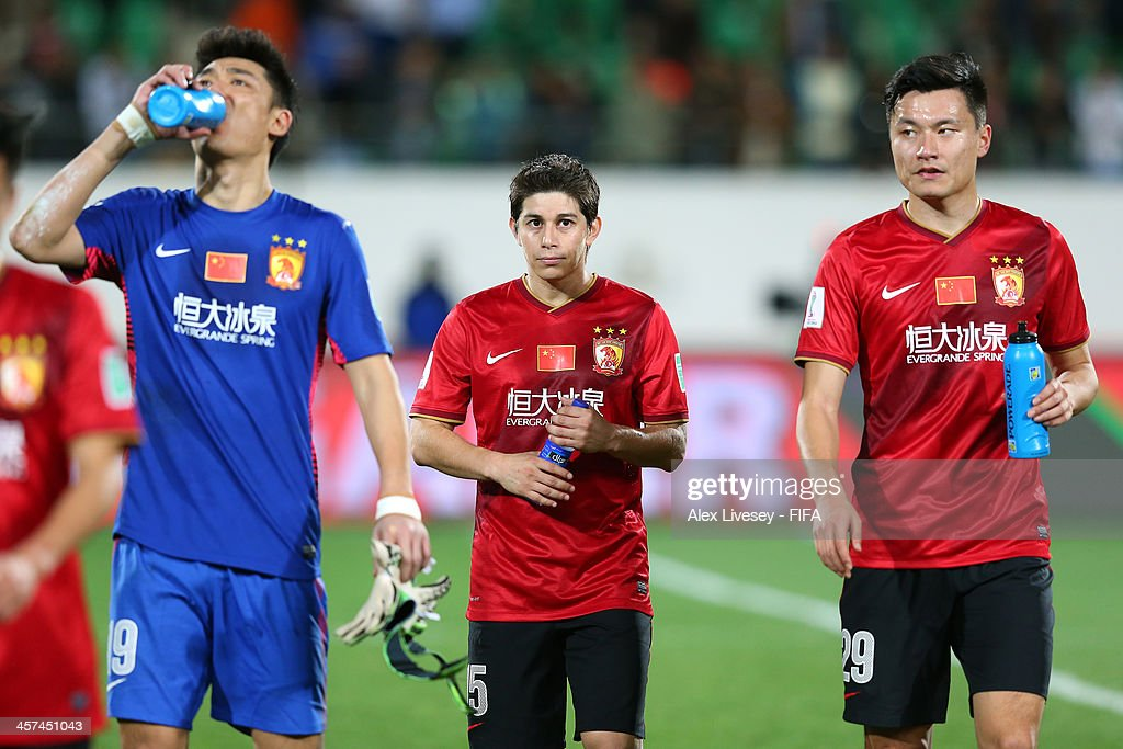 Dario Conca of Guangzhou Evergrande FC walks off the pitch after the FIFA Club World Cup Semi Final match between Guangzhou Evergrande FC and Bayern...