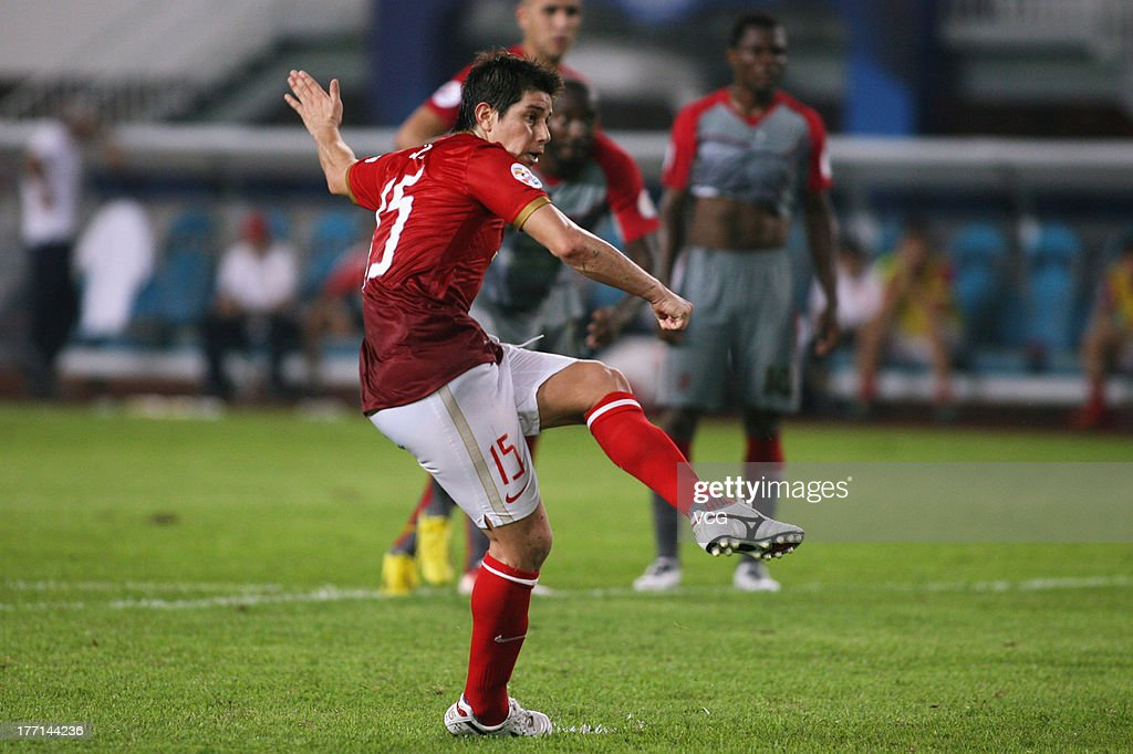 Dario Conca of Guangzhou Evergrande scores his team's first goal with a penaltykick during the AFC Champions League quarterfinal match between...