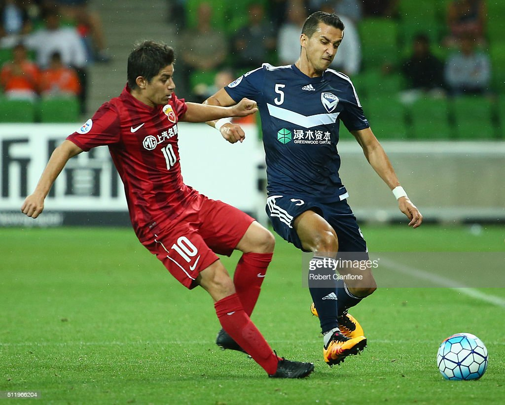 Dario Conca of Shanghai SIPG challenges Daniel Georgievski of Melbourne Victory during the AFC Asian Champions League match between Melbourne Victory...