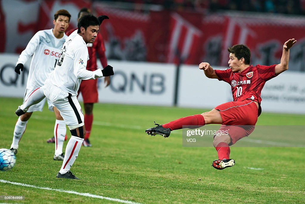 Dario Conca of Shanghai SIPG scores his team's second goal during the AFC Champions League playoff match between Shanghai SIPG and Muangthong United...