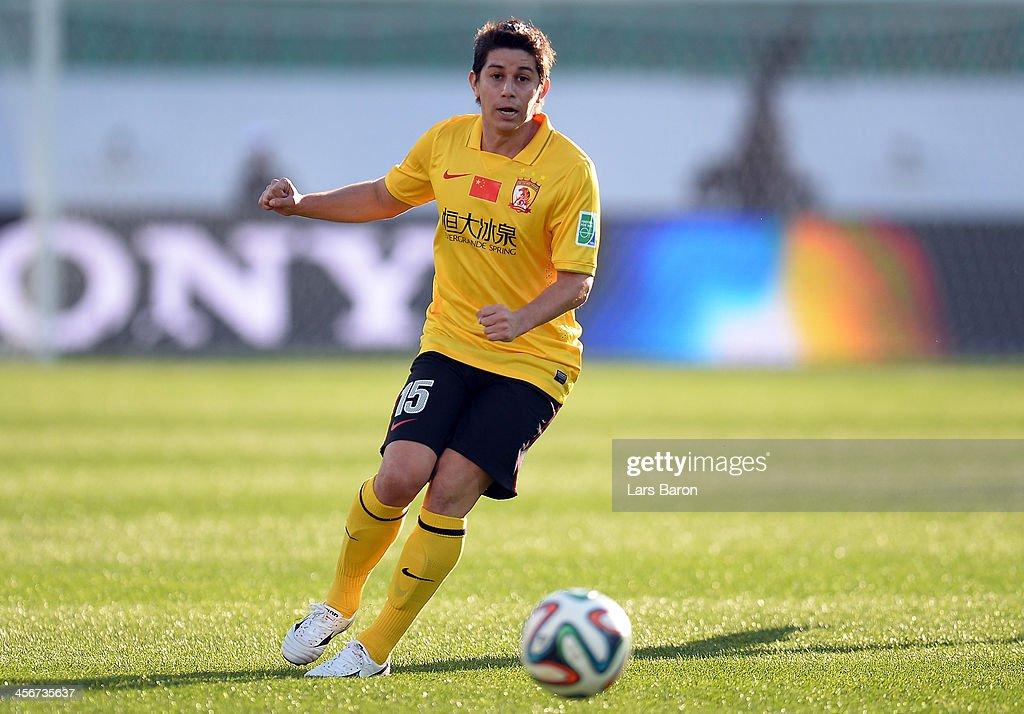 Dario Conga of Guangzhou runs with the ball during the FIFA Club World Cup quarterfinal match between Guangzhou Evergrande FC and AlAhly SC at Agadir...