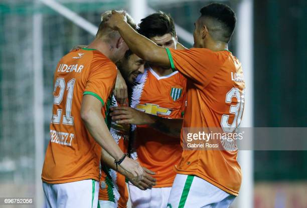 Dario Cvitanich of Banfield celebrates with teammates after scoring the third goal of his team during a match between Banfield and Rosario Central as...