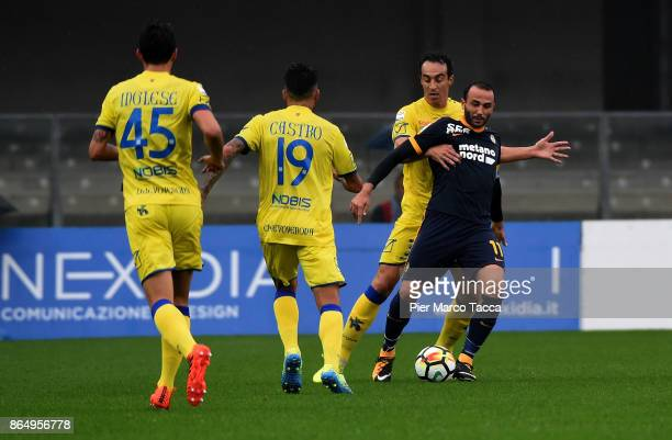 Dario Dainelli of AC Chievo competes for the ball with Giampaolo Pazzini of Hellas Verona during the Serie A match between AC Chievo Verona and...