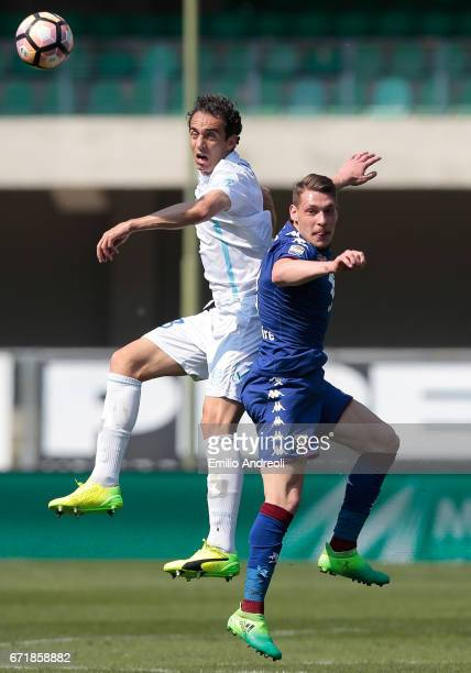 Dario Dainelli of AC ChievoVerona jumps for the ball with Andrea Belotti of Torino FC during the Serie A match between AC ChievoVerona and FC Torino...