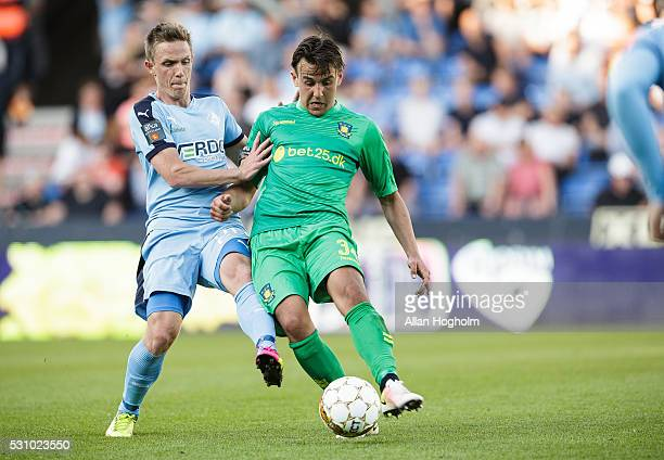 Dario Dumic of Brondby IF and Mads Fenger of Randers FC compete for the ball during the Danish Alka Superliga match between Randers FC and Brondby IF...