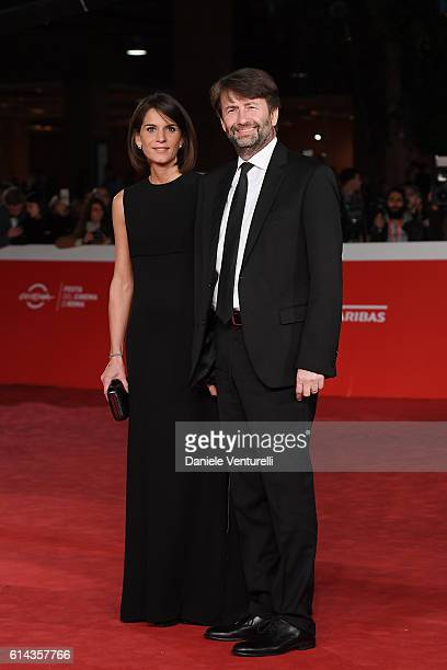 Dario Franceschini and Michela Di Biase walk a red carpet for 'Moonlight' on October 13 2016 in Rome Italy