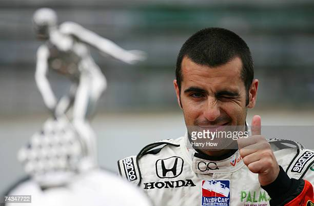 Dario Franchitti driver of the Canadian Club Andretti Green Racing Dallara Honda poses for a photo with the Official Borg Warner Trophy in...