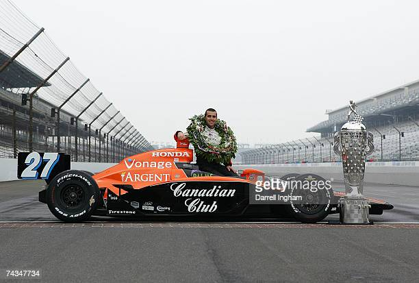 Dario Franchitti driver of the Canadian Club Andretti Green Racing Dallara Honda poses for a photo during the Official Borg Warner Trophy...