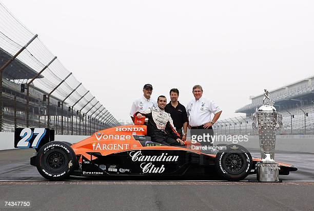 Dario Franchitti driver of the Canadian Club Andretti Green Racing Dallara Honda poses for a photo with Andretti Green Racing owners Kim Green...