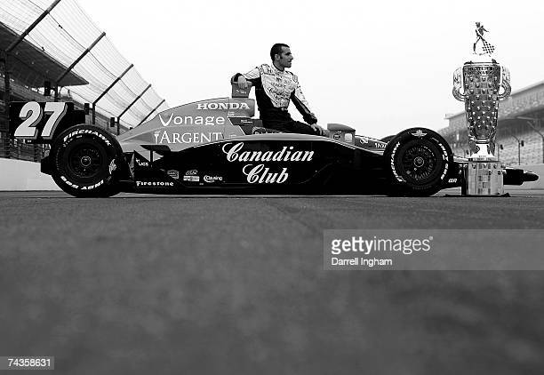 Dario Franchitti driver of the Canadian Club Andretti Green Racing Dallara Honda looks towards the Official Borg Warner Trophy during the...