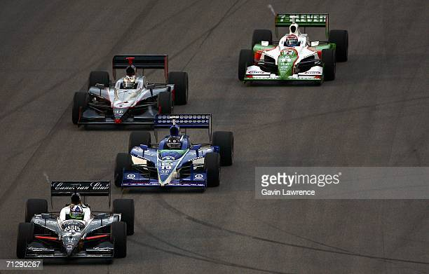 Dario Franchitti driver of the Klein Tools/Canadian Club Andretti Green Racing Jim Dallara Honda leads Dan Wheldon driver of the Target Ganassi...