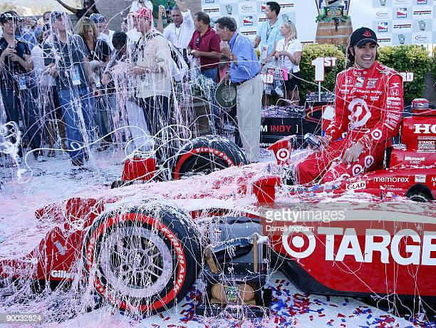 Dario Franchitti driver of the Target Chip Ganassi Racing Dallara Honda is showered with silly string after winning the IRL IndyCar Series Indy Grand...