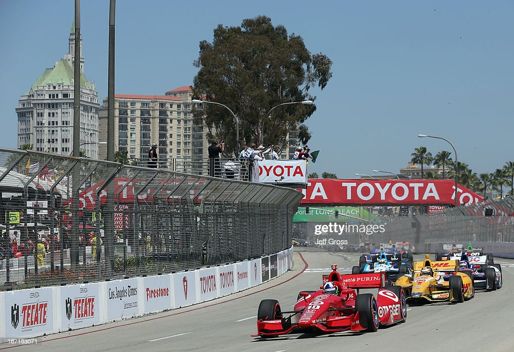 <a gi-track='captionPersonalityLinkClicked' href=/galleries/search?phrase=Dario+Franchitti&family=editorial&specificpeople=171306 ng-click='$event.stopPropagation()'>Dario Franchitti</a> of Scotland and driver of the #10 Target Chip Ganassi Racing Dallara Honda leads the field at the start of the IndyCar Series Toyota Grand Prix of Long Beach on April 21, 2013 in Long Beach, California.