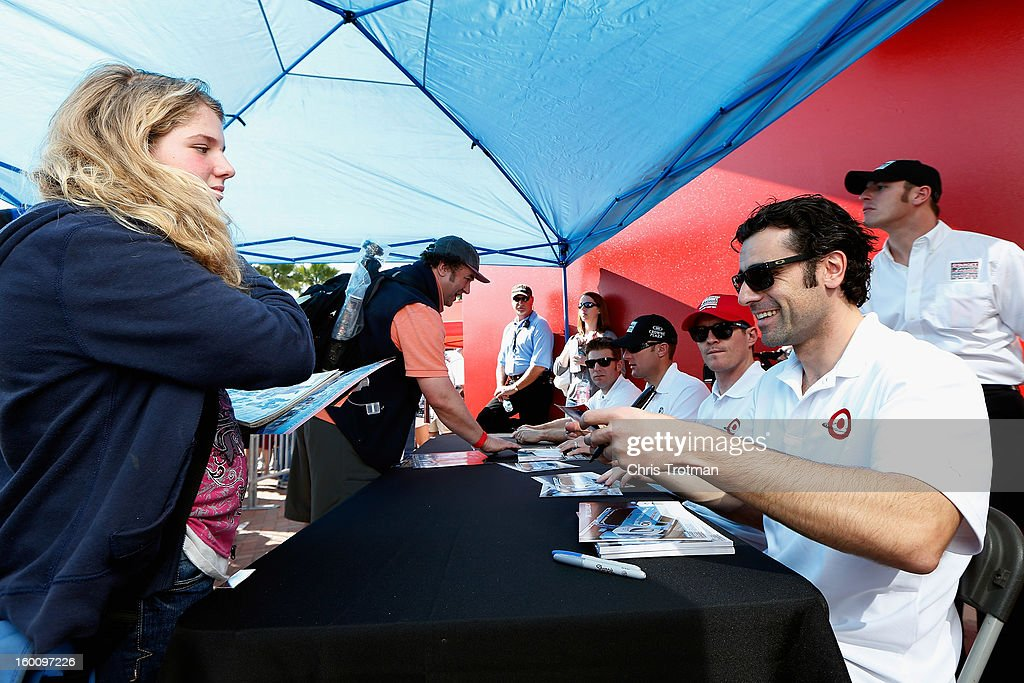 Dario Franchitti of Scotland, driver of the 02 Chip Ganassi Racing with Felix Sabates Target/Telmex BMW Riley signs autographs for fans with his co-drivers Scott Dixon, Jamie McMurray, Joey Hand at the Rolex 24 at Daytona International Speedway on January 26, 2013 in Daytona Beach, Florida.