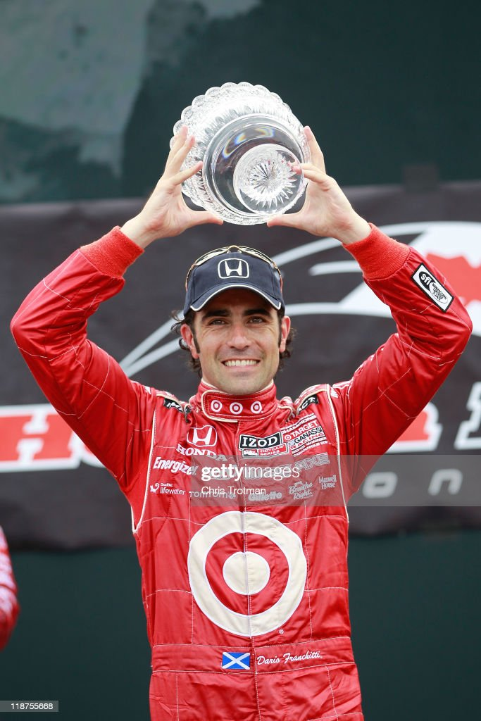 <a gi-track='captionPersonalityLinkClicked' href=/galleries/search?phrase=Dario+Franchitti&family=editorial&specificpeople=171306 ng-click='$event.stopPropagation()'>Dario Franchitti</a> of Scotland, driver of the #10 Target Chip Ganassi Racing Dallara Honda, lifts the trophy following his victory in the IZOD IndyCar Series Honda Indy Toronto on July 10, 2011 in the streets of Toronto, Ontario, Canada.