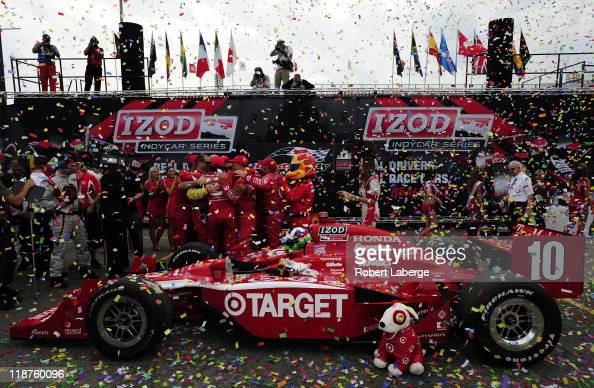 Dario Franchitti of Scotland driver of the Target Chip Ganassi Racing Dallara Honda celebrates with his teammates after winning the IZOD IndyCar...