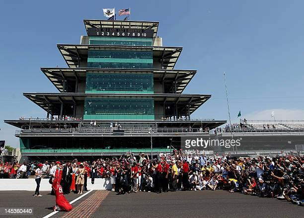 Dario Franchitti of Scotland driver of the Target Chip Ganassi Racing Honda celebrates at the yard of bricks after winning the IZOD IndyCar Series...